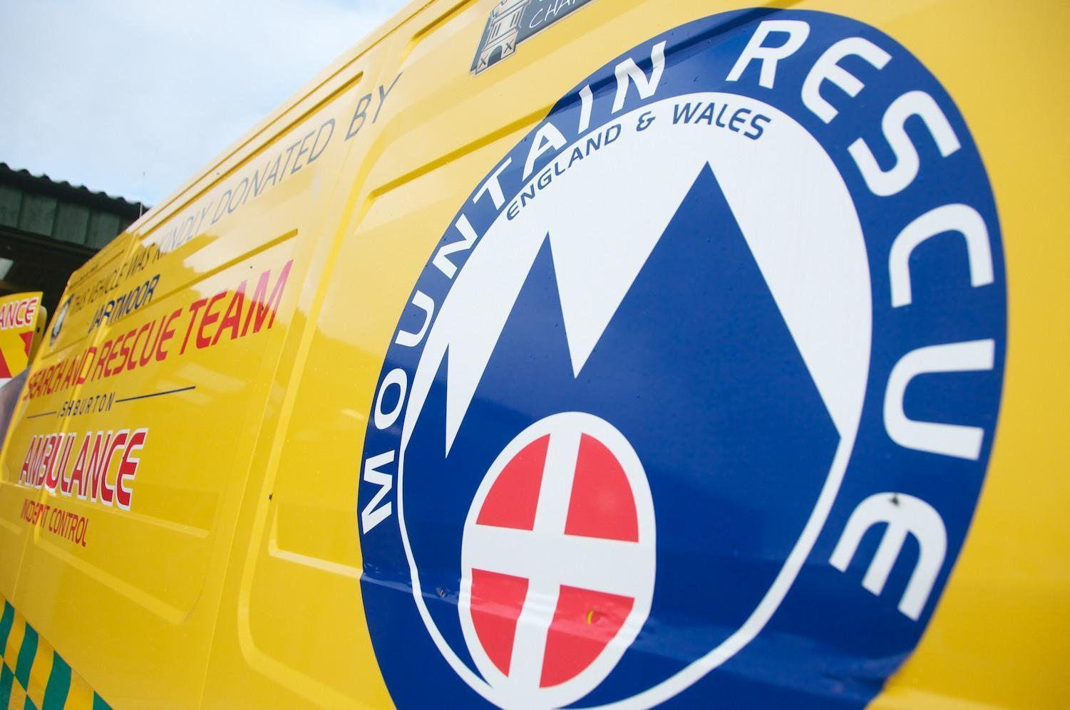 Side of control vehicle displaying mountain rescue logo