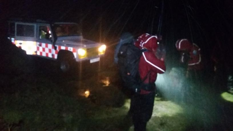 Dartmoor Search and Rescue landrover drops off a search team at Avon Dam reservoir at night in search for lone walker