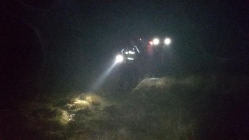 Dartmoor Rescue Ashburton searchers and their search torches looking for lone hyperthermic walker at Huntingdon Warren