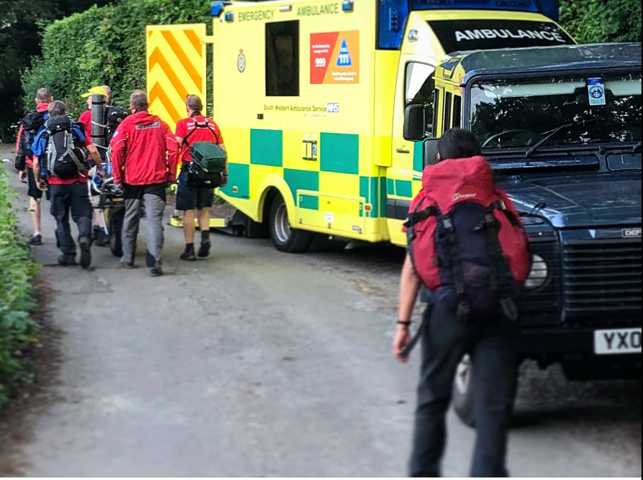 Dartmoor Rescue handing over a lady with a broken ankle to the ambulance at Lustleigh Cleeve.