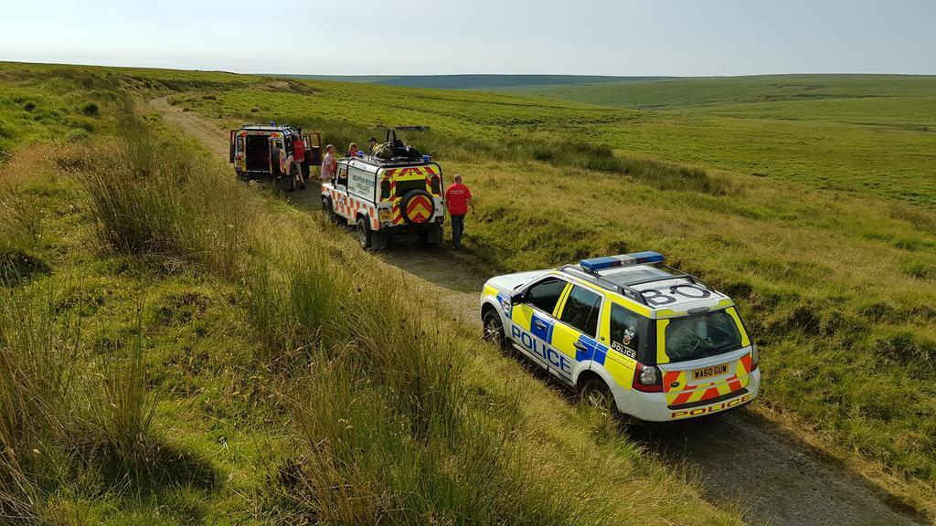 Police and Dartmoor Rescue Landrovers looking for a missing walker at Redlake