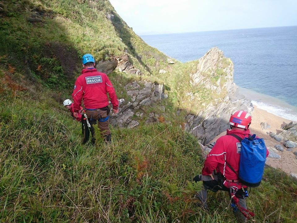 Dartmoor Search and Rescue volunteers searching steep ground near the coast in South Devon