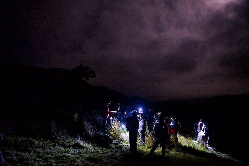 Dramatic night time sky as Dartmoor Rescue volunteers entertain walkers on its popular Dartmoor in the Dark event at Crockern Tor.