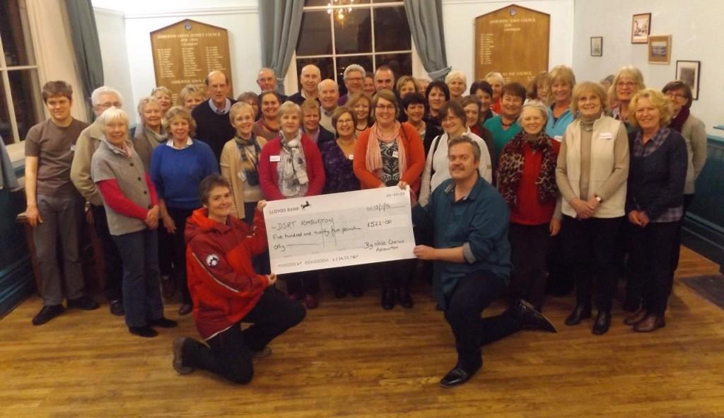 Big Noise Chorus cheque presentation to Ashburton charity Dartmoor Search and Rescue