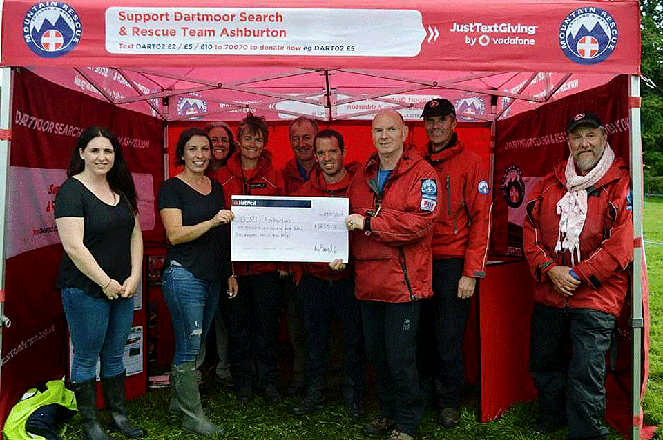Debbie Coles from Ullacombe Farm presenting a cheque for £3,489.68' to Dartmoor Search and Rescue Ashburton's Dave Underhill.