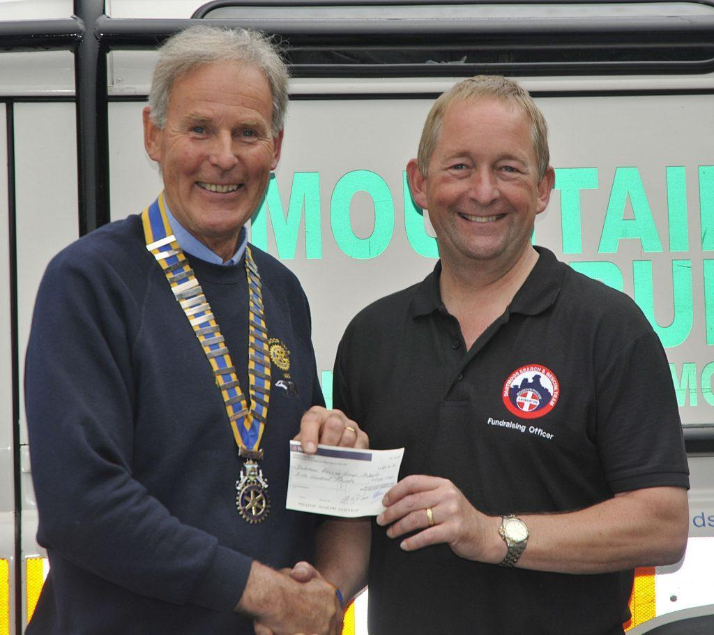 dartmoor vale rotarian cheque presentation to Devon search and rescue charity Dartmoor Search and Rescue Ashburton