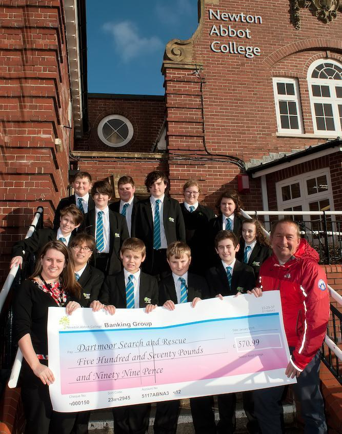 Newton Abbot College presents a cheque donation to local Devon rescue charity Dartmoor Search and Rescue