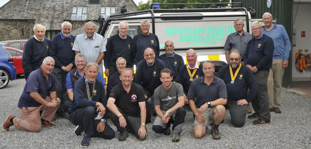 newton abbot rotary club present a cheque to Devon charity Dartmoor Search and Rescue Ashburton after a visit to the Devon charity's rescue centre