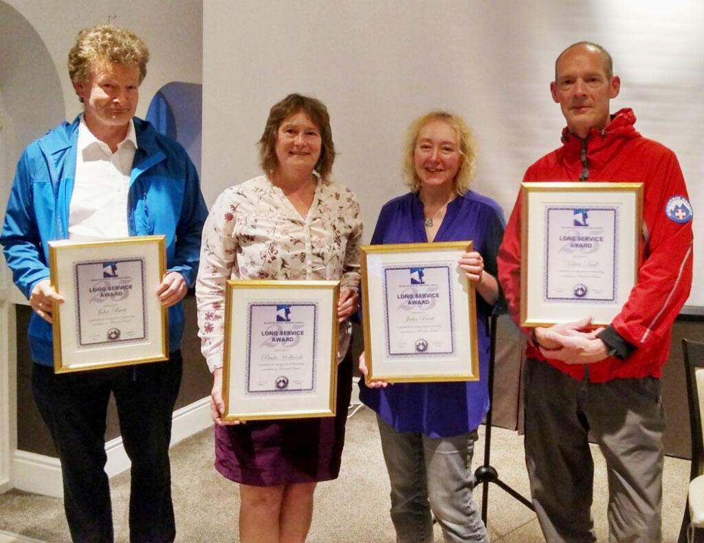 John Brett, Paula Holbrook, Julia Brett and Kelvin Bull presented with their 25 years long service to Dartmoor rescue certificates.