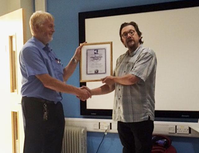 Ian Lowcock (left) receiving his 25 year long service certificate from Team Leader Keith Lambeth