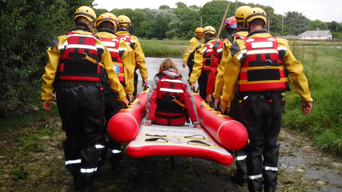 Dartmoor Search and Rescue Ashburton water team members carrying a casualty on a Water Rescue Systems sled