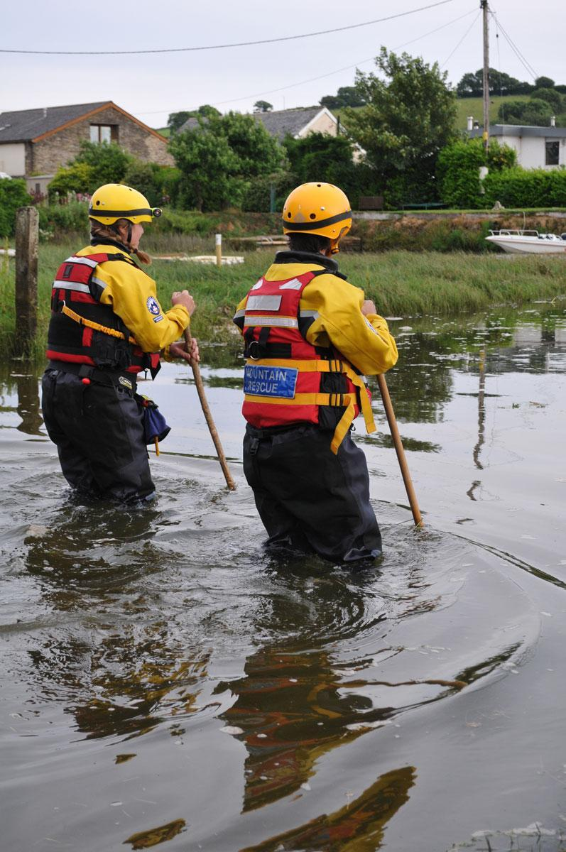 Dartmoor Search and Rescue volunteers wading the River Aune during a training exercise in the South Hams