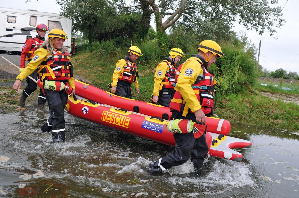 Dartmoor Rescue volunteers entering the River Aune at Aveton Gifford whilst training