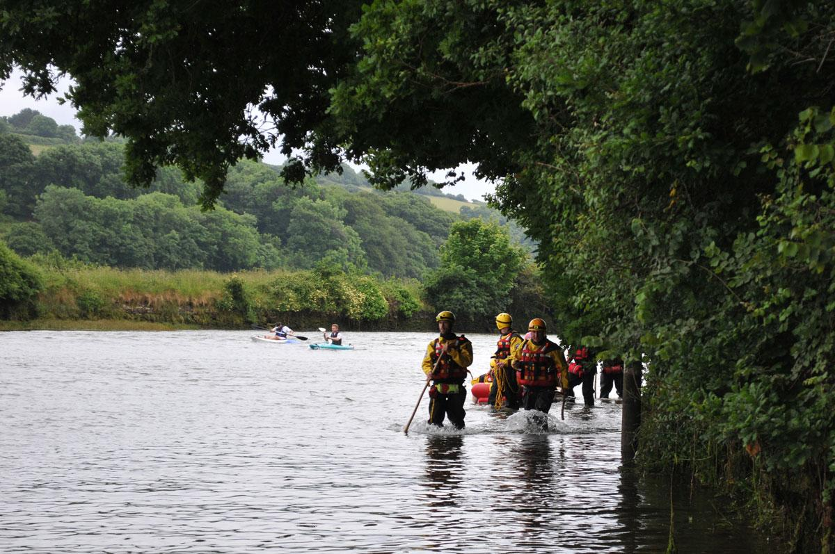 Dartmoor rescue members wading the River Aune tidal road at Aveton Gifford
