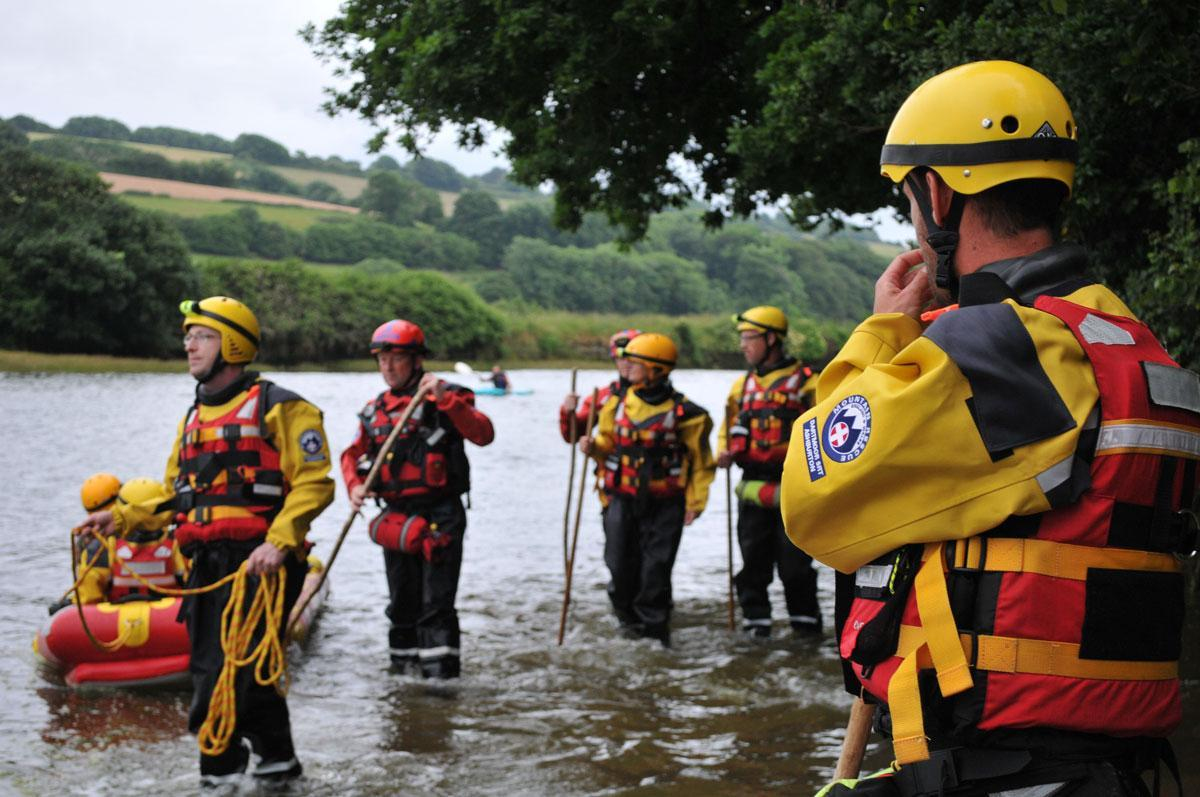 Dartmoor Rescue team members wading the River Aune tidal road at Aveton Gifford with a Water Rescue Systems sled.