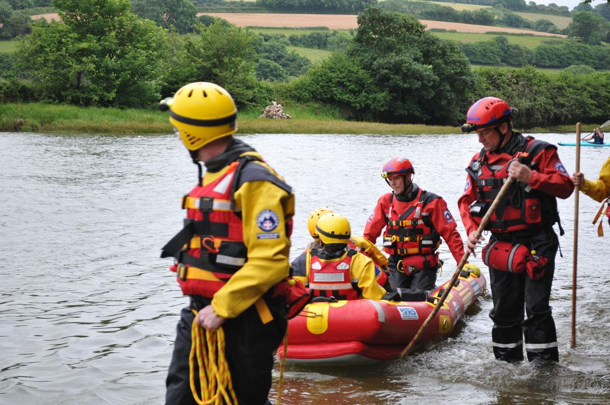 Dartmoor Rescue personnel training with a Water Rescue Systems sled on the tidal road at Aveton Gifford
