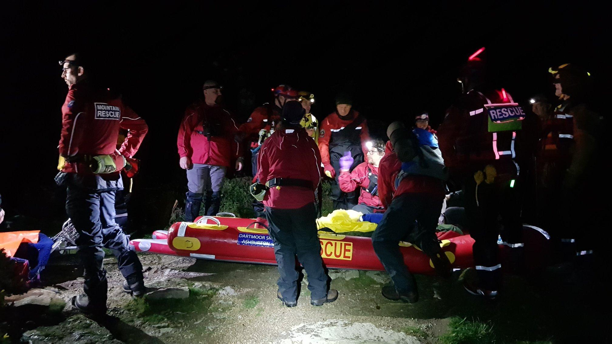 A casualty receives CPR on a Dartmoor rescue sled after being rescued from a rock ledge by a pond